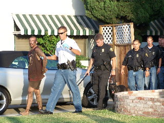 Police arrest suspect found in attic, 2100 block Florida Ave, July 12/05