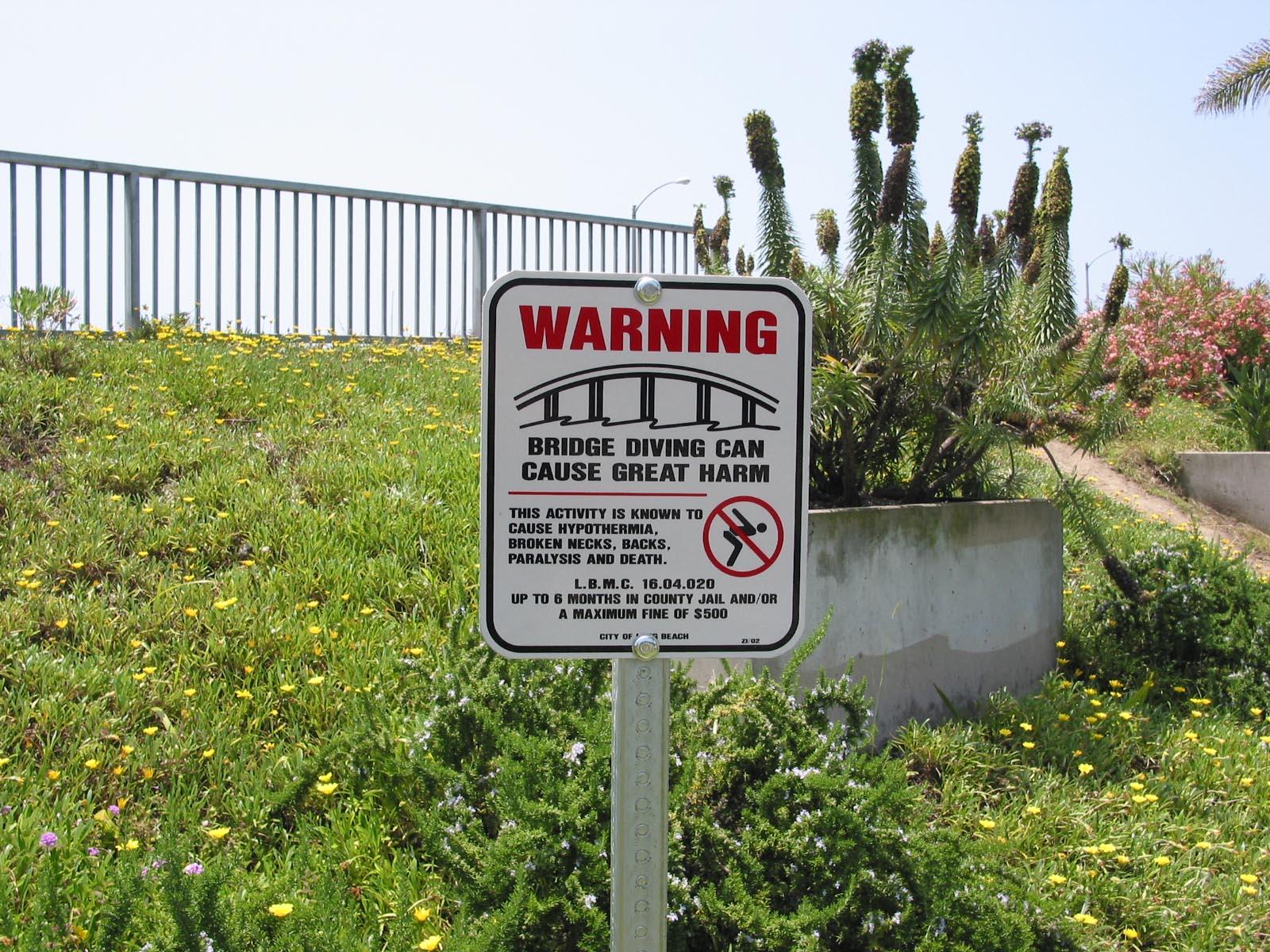 Bridge diving warning sign